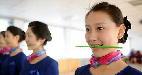 2008 Beijing Olympics hostess girls training smile with chopstick