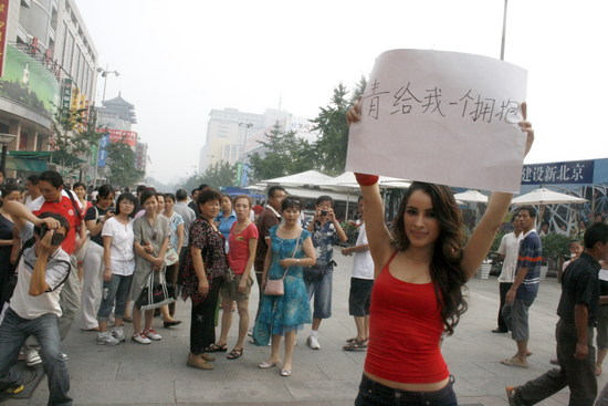 Days before the 2008 Olympic Games, a foreigner in Beijing holds up a sign: