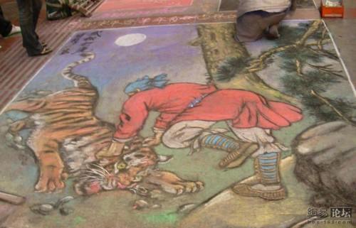 Guiyang street art: Man fighting tiger.