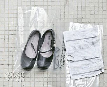 12-year-old Hong Kong schoolgirl's possessionsL shoes, glasses, notes.