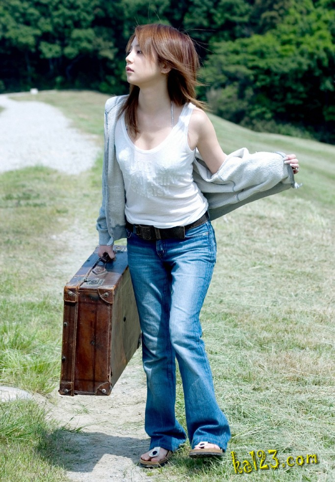 asian girl carrying suitcase