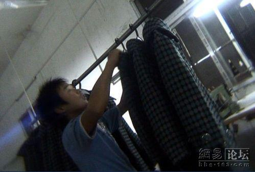 Child hanging up clothes.