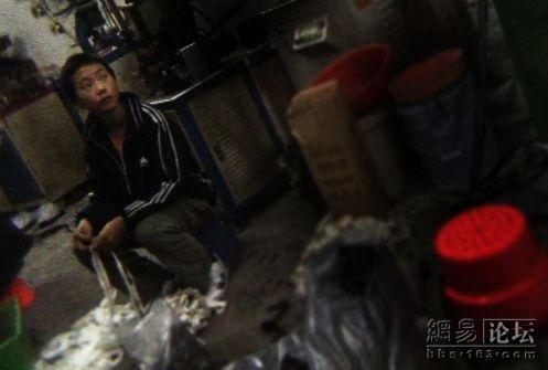 Boy working in a factory.