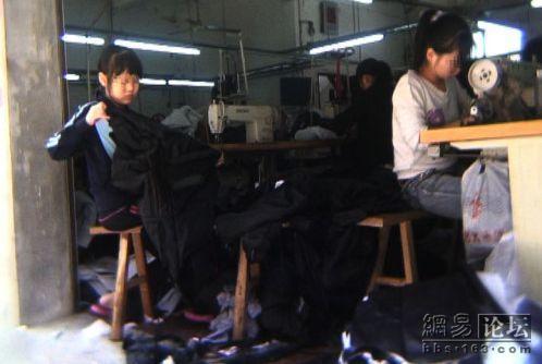 Young girls working in a clothing factory.