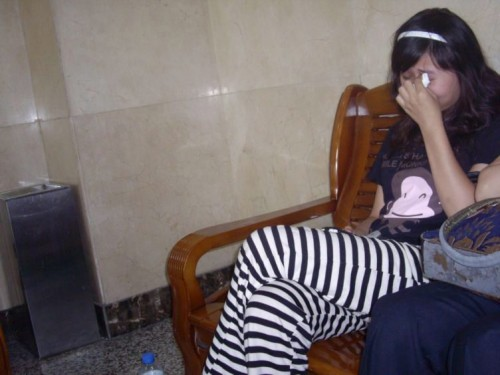 A Chinese girl cries after being bullied by government officials and police.