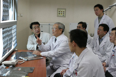 Chinese doctors reviewing and discussing x-rays.