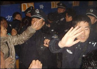 Harbin police fend off onlookers and civilians.