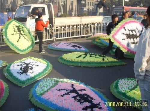 Flower wreaths placed near scene of crime.