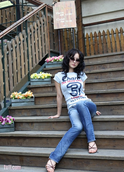 Pretty Asian girl on steps.