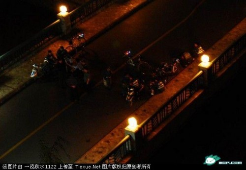 Shanghai police block off a road after Chinese students protest against Japanese students.