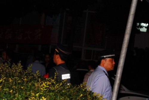 Police standing guard outside the university foreign student dormitories.
