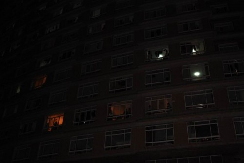 The foreign student dorms light up as foreign students inside wonder why there are many angry Chinese students outside.
