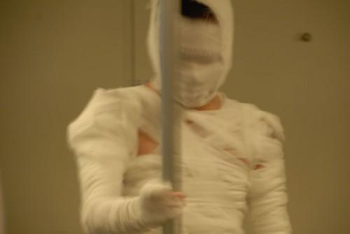 Chinese guy dressed as mummy on Shanghai subway.