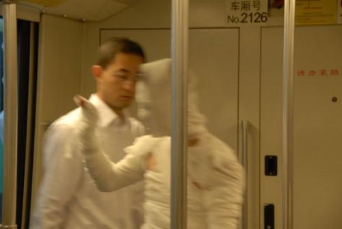 Shanghai subway mummy waves to other passengers.