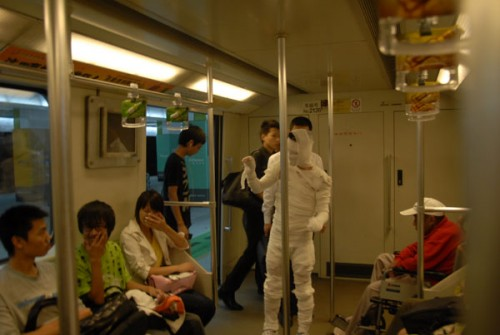 Chinese mummy scares other subway passengers.