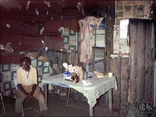 A lonely black woman living by herself in a broken-down building.
