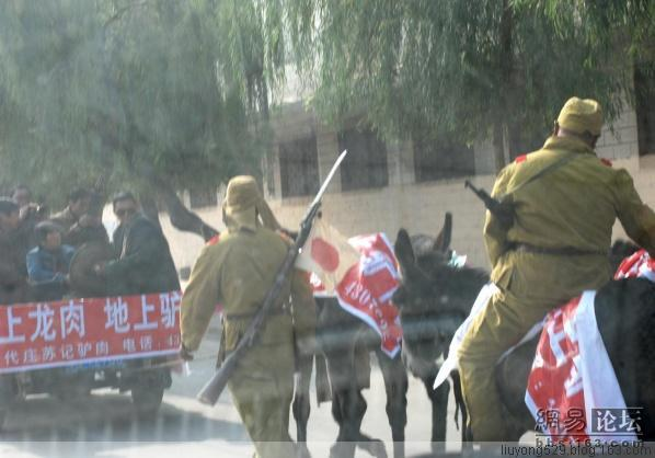 'Japanese soldiers' ride donkeys through Henan advertising a donkey meat store.