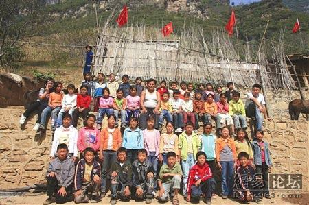 Group picture of Yi minority elementary school students in China.