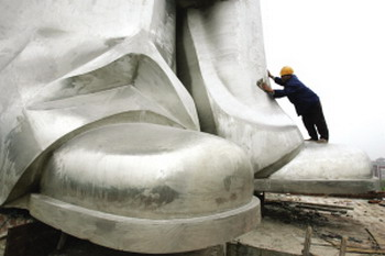 The huge feet of a Mao Zedong statue at a university campus in China.
