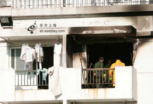 Room 602 of a girl's dormitory at Shanghai Business University with black smoke stains after fire.