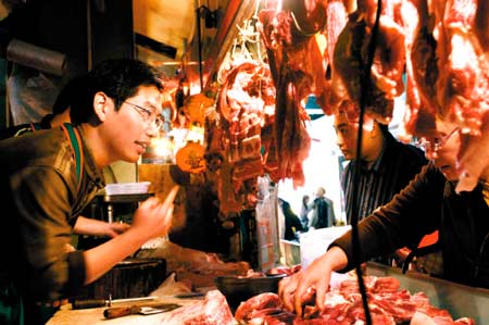 A Chinese graduate with a master's degree sells pork.