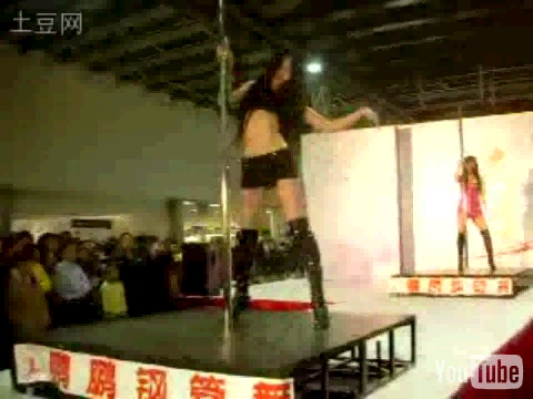 A video of a Pengpeng, a Chinese male pole dancer from Shenyang City in China, performing in a club. Bonus video of some sexy female pole dancers.