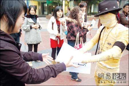 Dancing mummies in Wuhan, China hand out resumes.