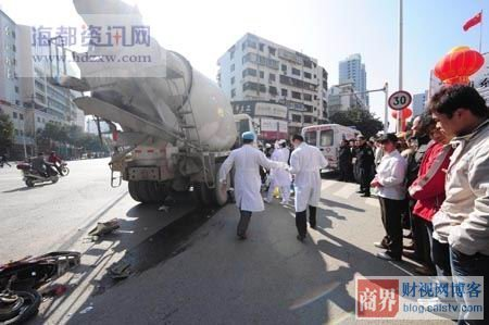 Bystanders in Fuzhou look on, a trail of blood behind the concrete truck's rear tire.