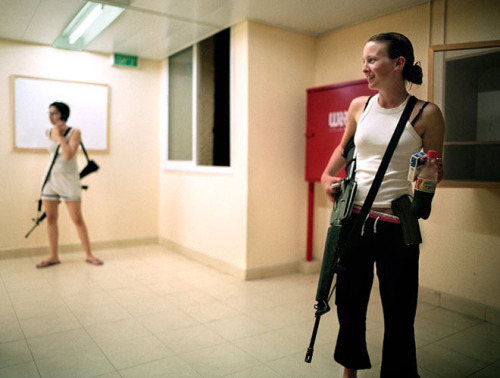 Two Jewish girls in Israel carrying their guns.