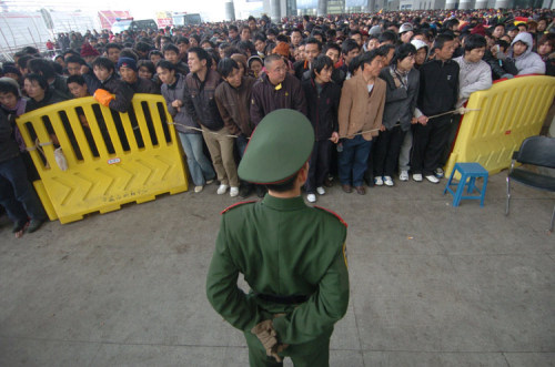 Pictures of long lines and large crowds of Chinese people trying to buy train tickets to travel home for the 2009 Spring Festival / Chinese New Year holiday.