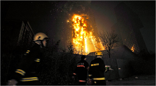 CCTV's headquarter's building in Beijing catches on fire. Chinese netizens report the news online with pictures & videos. The government then tries to censor.
