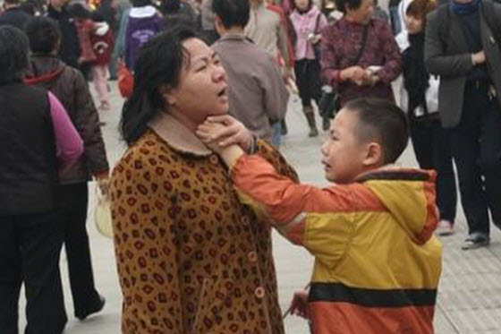 Pictures of a young Chinese boy making a scene in public when his mother refuses to buy him a toy he wants. Soon he slaps her, grabs her hair, and chokes her.