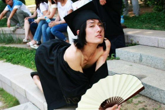 Sexy, flirtatious, silly photographs of a Chinese university schoolboy in a graduation gown spread on China's internet, making the pretty boy famous overnight.