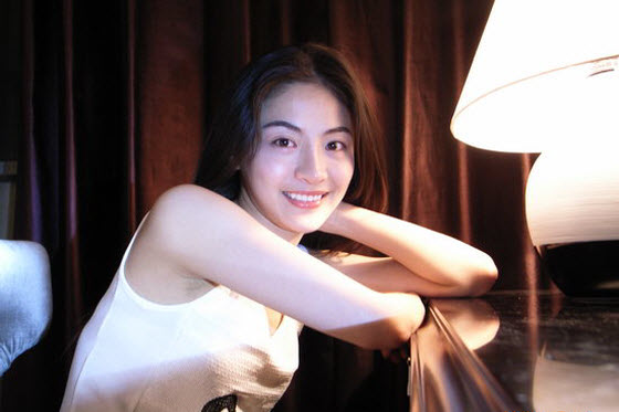 Gong Mi is a contestant on China's version of American Idol who first became popular for her Cecilia Cheung looks and then for whether she had plastic surgery.
