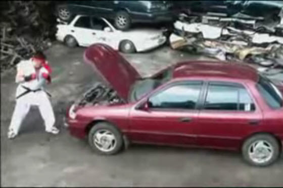 A video of a young man dressed like Ryu from the famous Street Fighter video game using his bare hands to destroy a car just like the bonus stage in the game.