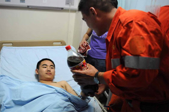 A boy famous for wanting a cold Coke upon being rescued during the Sichuan Earthquake will get free admissions to university. Chinese netizens say it is unfair.