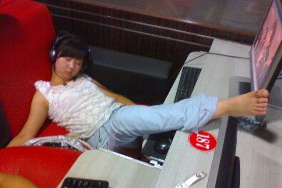 A series of funny and outrageous photographs taken of Chinese people asleep in China's internet bars. Many 24 hour internet bars have cheaper