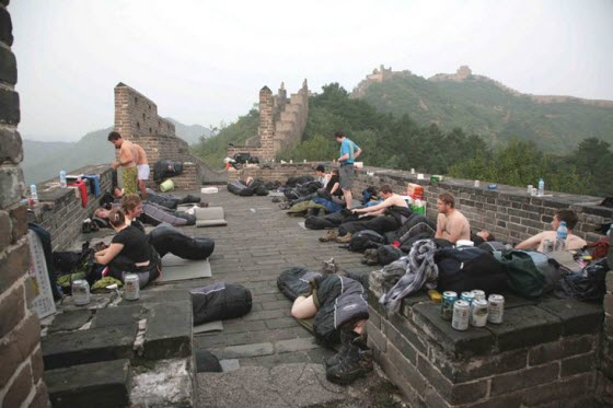 Chinese netizens react angrily to images appear of foreigners camping on the Great Wall of China, blaming disrespectful foreigners & greedy tourism management.