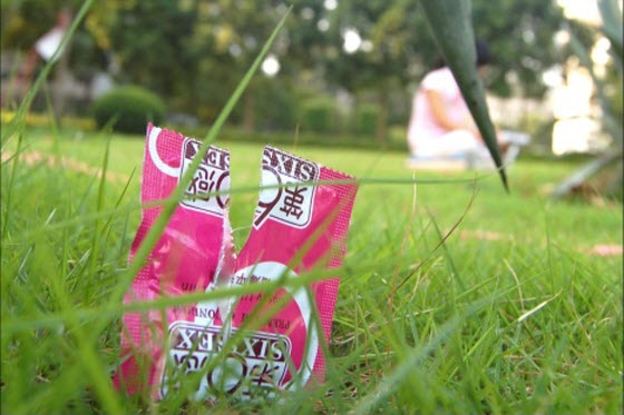 Photos of various condoms & packaging discarded by amorous college couples in secluded corners of China's university campuses disgust & amuse Chinese netizens.
