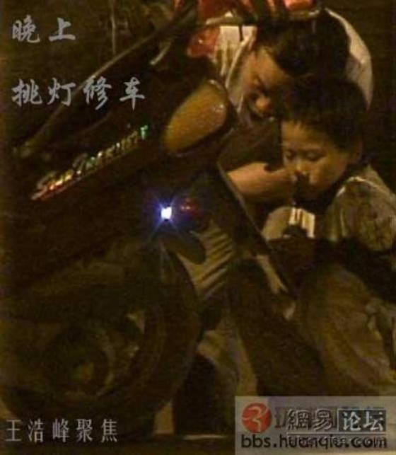 12-year-old fixing car at night