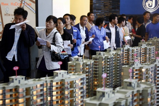 Chinese people in line to buy a house.