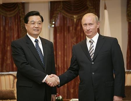 putin-hu-jintao-handshake-02