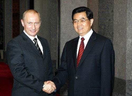 putin-hu-jintao-handshake-03