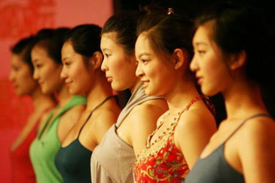 Criteria for hiring female train attendants in China include being under 20-years old, over 1.65m tall, under 50kg, pretty appearance & good personal character.