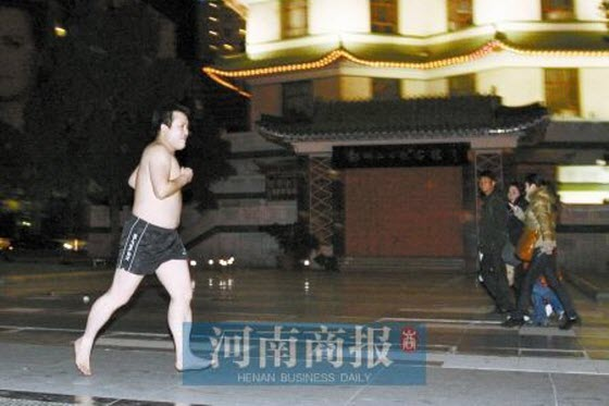 A young man in Henan, China protests overpriced and increasing housing and real estate prices by running around the city during winter nearly completely naked.