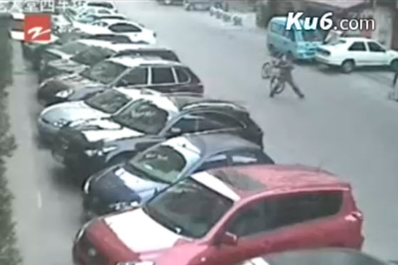 A Wenzhou, China man is featured on the news after stopping purse-snatching motorcycle thieves by picking up & throwing his bicycle at them, knocking them down.