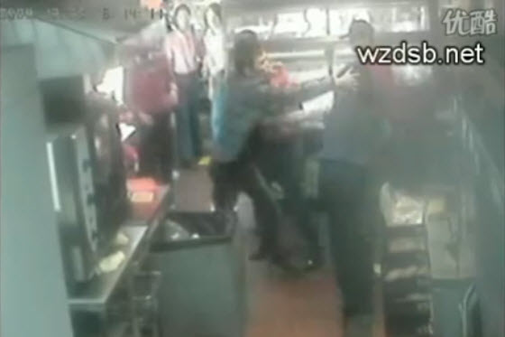 Surveillance video in a fast food restaurant in China captures a man charging in & repeatedly attacking a 2-month pregnant store manager over an ice cream cone.