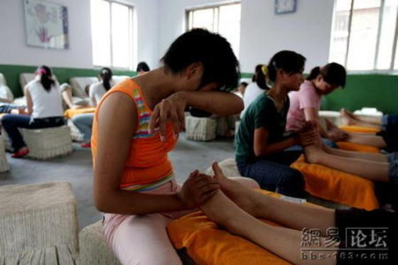 Netizens discuss photographs that chronicle the lives of rural Chinese girls studying foot massage to find work many consider degrading in China's major cities.