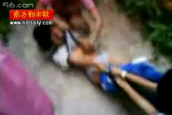 A middle school female student is filmed being attacked and humiliated by other schoolgirls in an alley in Zhongshan, Guangzhou in China while others watch on.