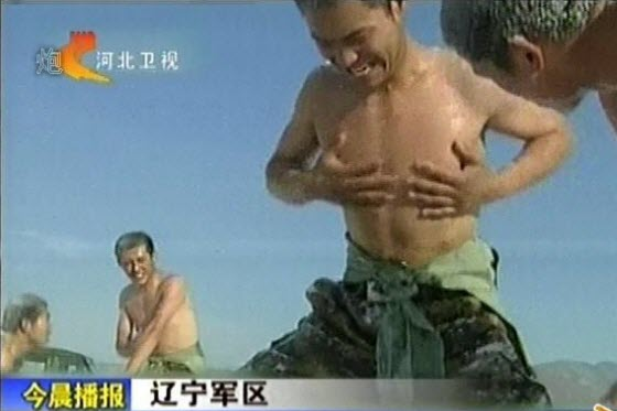 Chinese netizen reactions to images from a TV news report of naked Chinese soldiers in Liaoning burying themselves in snow to build-up their cold-resistance.